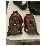 Pair of carved Asian faces