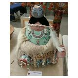 Native doll with pots one on head