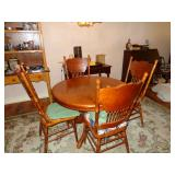 48 in. oak table and 4 chairs w/ 18 in leaf