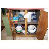 Kitchen items in select cupboards