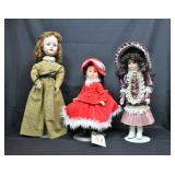 3 dolls with display stands