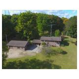 home and three acres plus garages