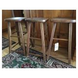 three small bar stools