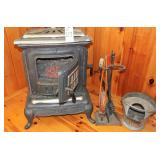Cast iron wood stove with insert and tools