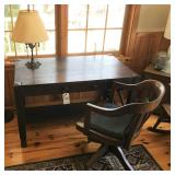 oak desk, office chair and iron lamp