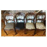 Four matching chairs with padded seats