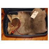 totes of elk and deer pelts