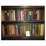3 shelves of antique books