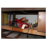 Electric chainsaw, sander, empty tool boxes
