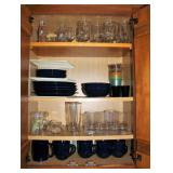 Cupboard full of glassware and Gibson Serving Set