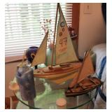 Stand with sail boats and decor