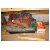 Shelf with safety vests, ice sled with tarps,tents