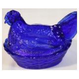 Cobalt blue hen on a nest