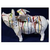 Cast iron paint splattered flying pig