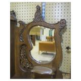 ornate mirror and woodwork>