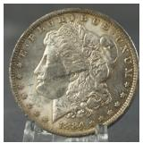 1884-O AU Morgan Silver Dollar