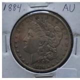 1884 Morgan AU Silver Dollar
