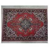 4 ft 10 in by 5 ft 5 in Red Weaved Area Rug