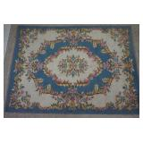 4ft 7in by 6ft 6in Pale Blue Pink Weaved Area Rug