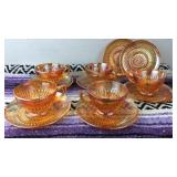 Lot of 5 cups and 7 Carnival glass saucers