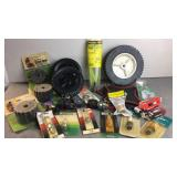Lot of lawnmower repair parts, spark plugs, brush
