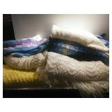 Assorted size pieces of non completed knitting