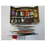 assorted model paints and brushes