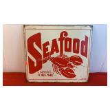 """Metal sign saying """"Seafood Always Fresh"""""""