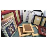 Collection of Photo Frames and Empty Photo Books