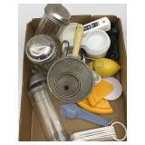 Measuring cups, measuring spoons, sugar shakers