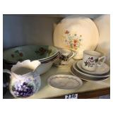 Shelf with flowered dishes