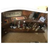 Bar sign glasses and liquor bottles