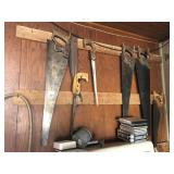 Saws hanging on wall