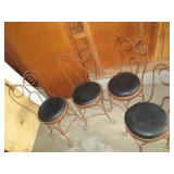 four cafe style chairs