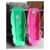 two plastic sleds