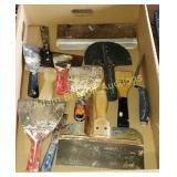 Assorted wallboard tools and putty knives