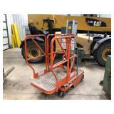 JLG model 12 SP scissor lift 12ft reach- push type