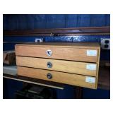 wooden 3 drawer cabinet with calibration pins