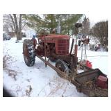 Farmall M with trip bucket loader