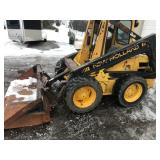 New Holland with New Crate Motor (800 Hrs.) w/ New tires and Steel track