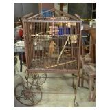 Metal framed wire bird cage on wheels