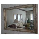 "Gold tone ornate framed beveled mirror, 41"" by 30"""
