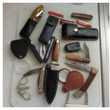 Pocket knives. magnifying glass, scissors