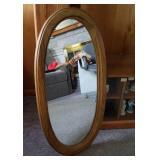 Duane wall mirror. Oval, heavy oak frame