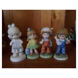 Boy and girl porcelain figures,