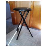 Black metal and vinyl folding stool,