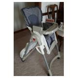 Evenflo high chair with tray. Adjusting height