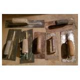 Masonry tools or carpet glue trowels