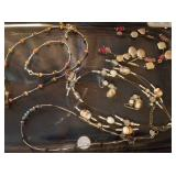 Necklace sets, 2 with earrings, one with bracelet