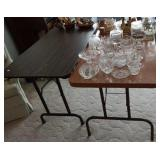 2 heavy top folding tables,  about 4 foot long